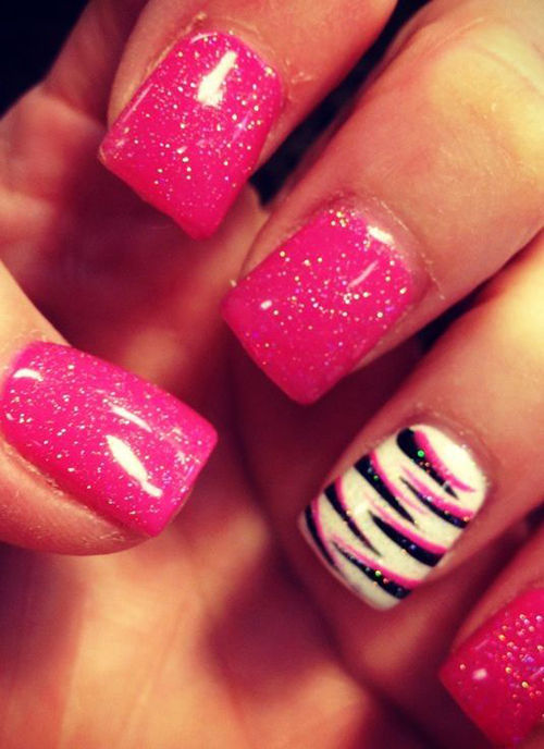 This is a trend that is here to stay. Have all nails painted one colour and do a lovely design on only one finger. Love the black and pink combo here too.