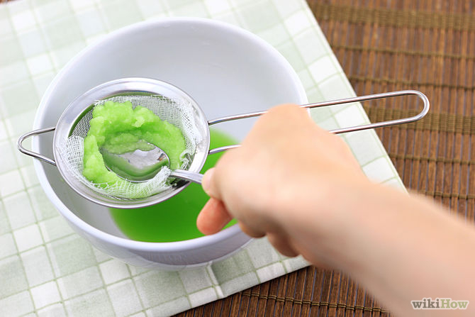 9. Stir the puree with a rubber spatula or metal spoon, occasionally pressing down into the cheesecloth or mesh. By stirring the cucumbers, you encourage the juice to seep out and flow through the strainers, into the bowl. Continue stirring and pressing until no more juice comes out.