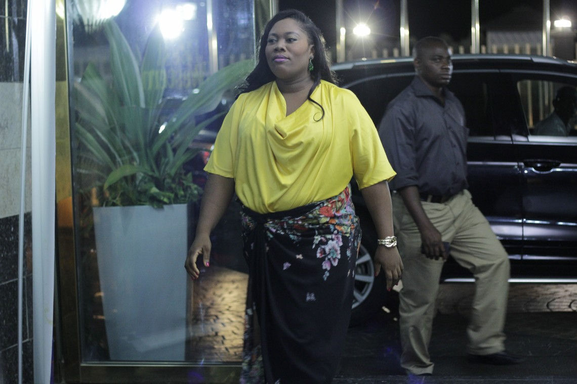 Toyin arrives back at the hotel for a dinner date with her husband.