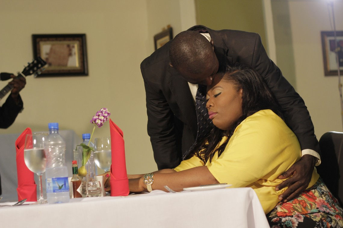 ...she begins to cry. Babatunde wipes her tears, kisses her, and promises to make more time for them in their marriage.