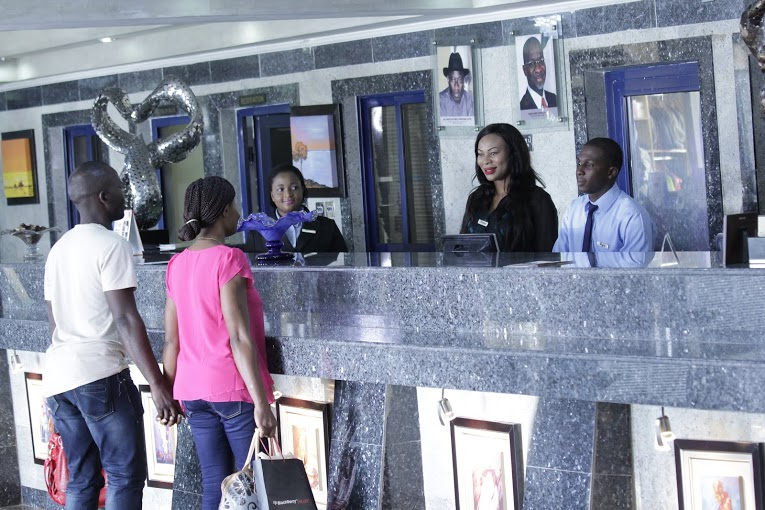 They get checked in to the Best Western Hotel, Victoria Island, Lagos.