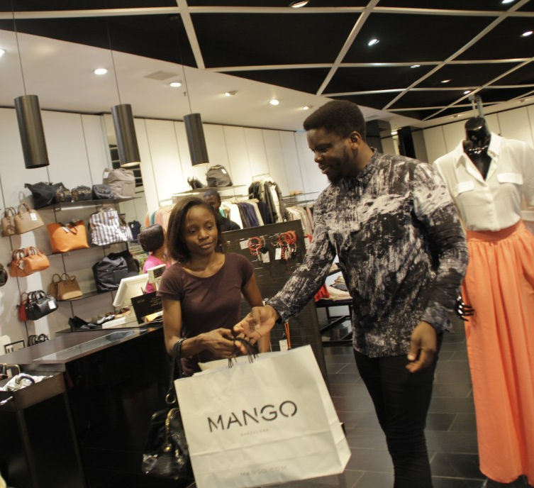 For Adewunmi, her honeymoon is becoming even more real and she wears a big smile as she meets up with Celebrity Stylist Moses at the Mango store to pick out some clothes.