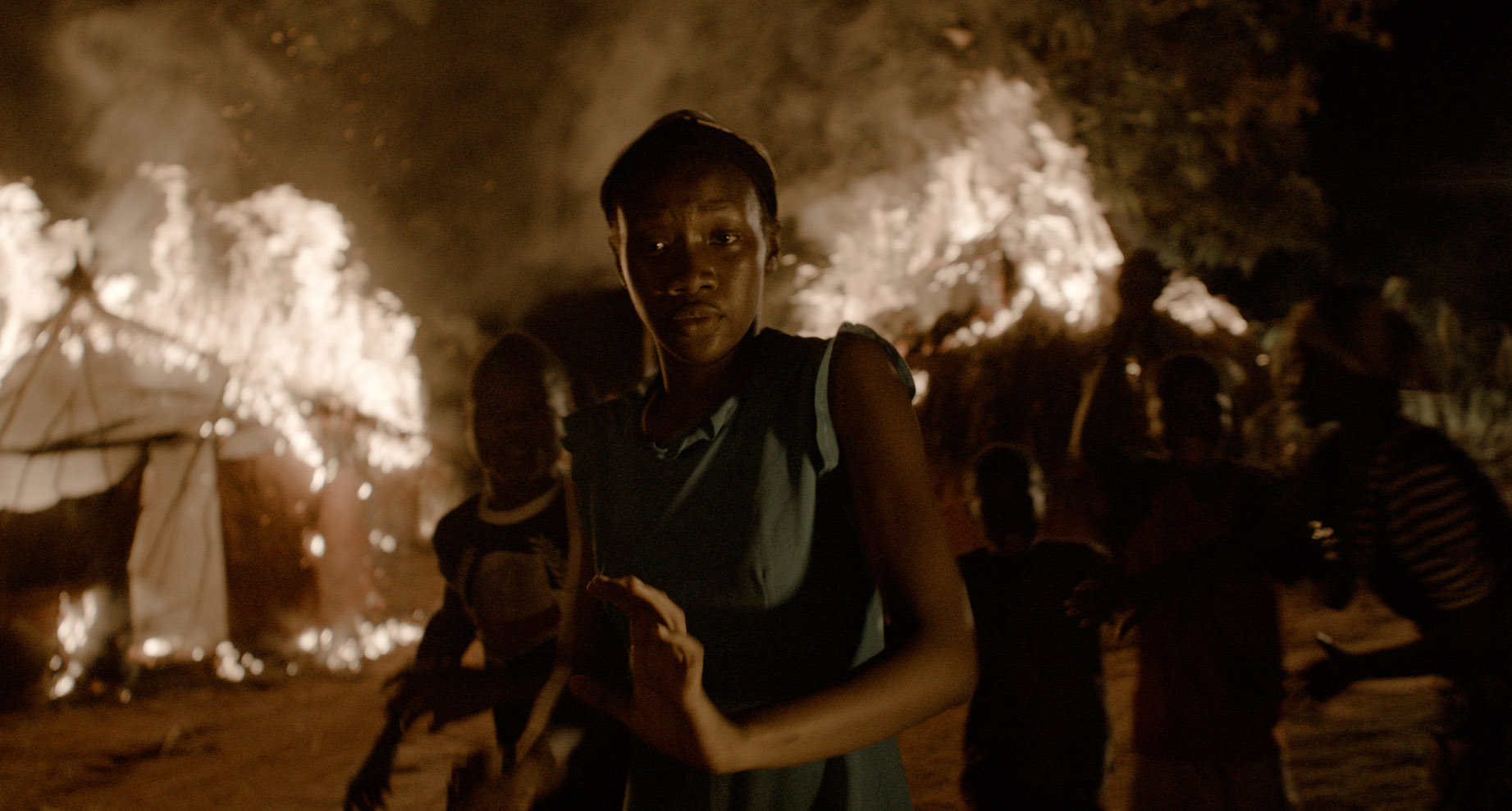 If you've watched the trailer, you must be familiar with this scene. Lots of people running away from a fire.